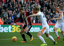 Sheffield United's Billy Sharp (Left) and Hull City's Max Clark battle for the ball during the Sky Bet Championship match at Bramall Lane, Sheffield.
