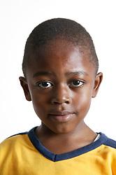 Portrait of a young black boy,