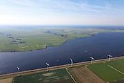 Nederland, Utrecht, Gemeente Eemnes, 06-09-2010; polders tussen Eemnes en Spakenburg gezien vanuit Flevoland. Een van de laatste open polderlandschappen in de Randstad, aan de horizon het Gooi. De polders zijn: Zuidpolder te Veld, Noordpolder te Veld, Maatpolder en  Bikkerspolder. .Polders between Eemnes and Spakenburg seen to Flevoland. One of the last open polder landscapes in the Randstad. .luchtfoto (toeslag), aerial photo (additional fee required).foto/photo Siebe Swart