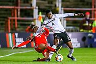 Trinidad and Tobago defender Sheldon Bateau holds off Wales midfielder Ben Woodburn during the Friendly European Championship warm up match between Wales and Trinidad and Tobago at the Racecourse Ground, Wrexham, United Kingdom on 20 March 2019.