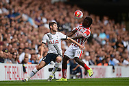 Ben Davies of Tottenham Hotspur competing with Mame Biram Diouf of Stoke City. Barclays Premier league match, Tottenham Hotspur v Stoke city at White Hart Lane in London on Saturday 15th August 2015.<br /> pic by John Patrick Fletcher, Andrew Orchard sports photography.