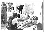 Topless sunbathers being photographed, Croissette and beach, Cannes, 14th May 1997, Cannes Film Festival © Copyright Photograph by Dafydd Jones 66 Stockwell Park Rd. London SW9 0DA Tel 020 7733 0108 www.dafjones.com