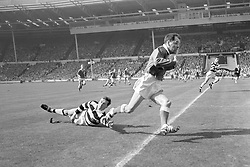 Graham Paul, Hull Kingston Rovers, evades a tackle from Widnes' Robert Chisnall.