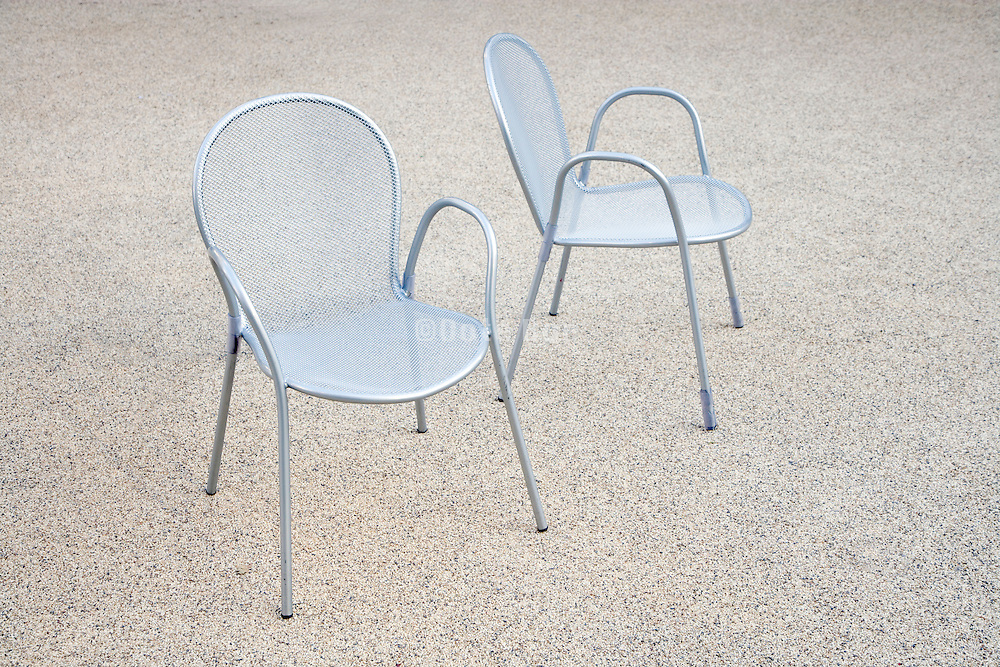 2 outdoor chairs on gravel