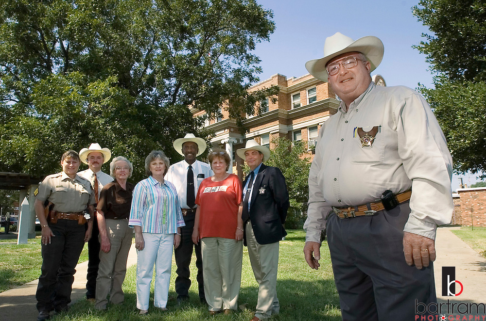 KEVIN BARTRAM/The Daily News.Freestone County Sheriff Ralph Billings, right, is pictured with several county employees in front of the courthouse in Fairfield on Wednesday, Sept. 28, 2005. Billings coordinated bringing busses from Galveston into Fairfield as they fled from Hurricane Rita. Billings passed the busses on to the school district where evacuees were housed.