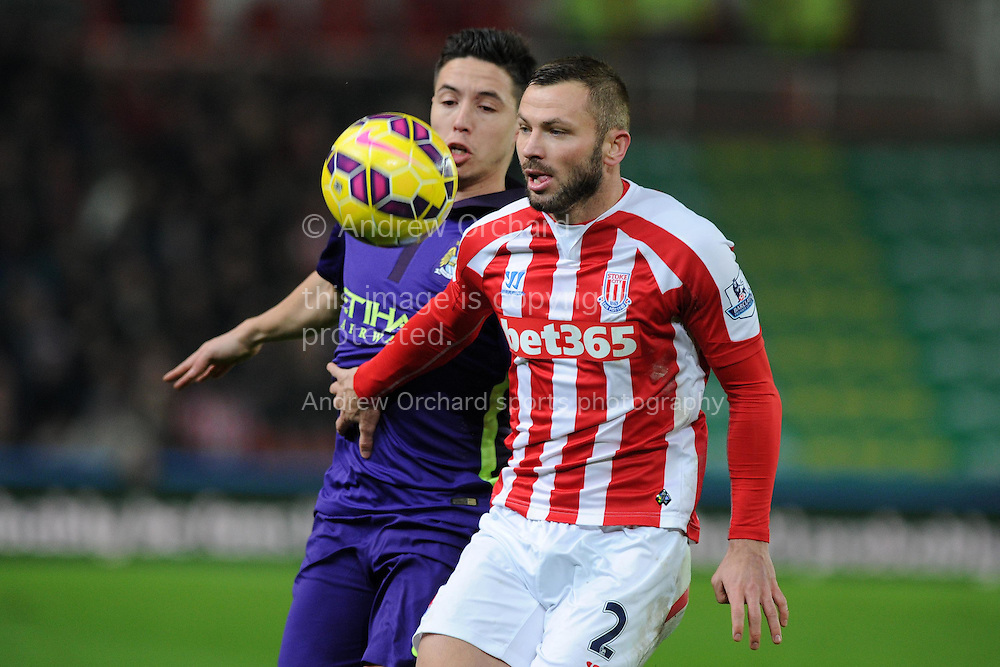 Phil Bardsley of Stoke city holds off Samir Nasri of Manchester city.   Barclays Premier League match, Stoke city v Manchester city at the Britannia Stadium in Stoke on Trent , Staffs on Wed 11th Feb 2015.<br /> pic by Andrew Orchard, Andrew Orchard sports photography.