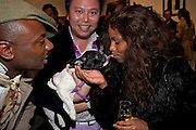 JIMMY HO ( BEHIND) HIS DOG LAYLA ROSE; ALEXIA SOMERVILLE,  Exhibition of photographs by Ellen von Unworth. Michael Hoppen Gallery. Jubilee Place, Chelsea. London. 22 October 2009.