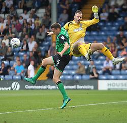 Murray Wallace of Scunthorpe United (L) fouls Joe Murphy of Bury - Mandatory by-line: Jack Phillips/JMP - 02/09/2017 - FOOTBALL - Gigg Lane - Bury, England - Bury v Scunthorpe United - English Football League One