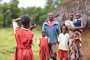 Cynthia photographing her family during  a Seedlight photography workshop