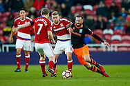 Middlesbrough midfielder Adam Clayton (8)  is challenged by Sheffield Wednesday forward Steven Fletcher (6)  during the The FA Cup match between Middlesbrough and Sheffield Wednesday at the Riverside Stadium, Middlesbrough, England on 8 January 2017. Photo by Simon Davies.