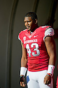 Nov 23, 2012; Fayetteville, AR, USA; Arkansas Razorbacks linebacker Tenarious Tank Wright (43) waits to be recognized for Senior Day before a game against the Louisiana State Tigers at Donald W. Reynolds Stadium.  LSU defeated Arkansas 20-13. Mandatory Credit: Beth Hall-US PRESSWIRE
