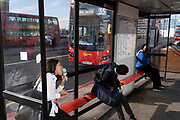 In the week that many more Londoners returned to their office workplaces after the Covid pandemic and the summer holidays, a woman licks an ice cream as commuters and public transport make their way southwards at the southern end of London Bridge in Southwark, on 8th September 2021, in London, England.