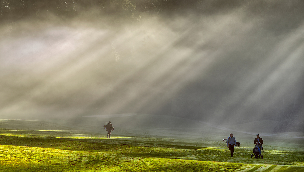 Golfers walk a fairway during a round of play on a winter's day in Roberts Creek, BC (2018)