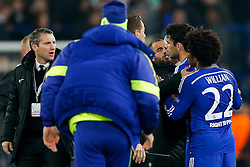 Diego Costa of Chelsea squares up to Paris Saint-Germain staff at full time after Chelsea are kncoked out on away goals - Photo mandatory by-line: Rogan Thomson/JMP - 07966 386802 - 11/03/2015 - SPORT - FOOTBALL - London, England - Stamford Bridge - Chelsea v Paris Saint-Germain - UEFA Champions League Round of 16 Second Leg.