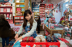 © Licensed to London News Pictures.05/12/2013. London, UK. Cath Kidston's employee arranges items on the shelves during the opening of the new Cath Kidston store at 180 Piccadilly, London. The new store is the largest Cath Kidston store in the world and  has over 20,000 products, including new ranges and services.Photo credit : Peter Kollanyi/LNP