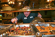 Carson 'Collard Green' Hughes Eating at an all you can eat seafood buffet in Newport News, Virginia, in preparation for a contest. He died at 44 in December 2008. (From the book What I Eat: Around the World in 80 Diets.)  MODEL RELEASED.