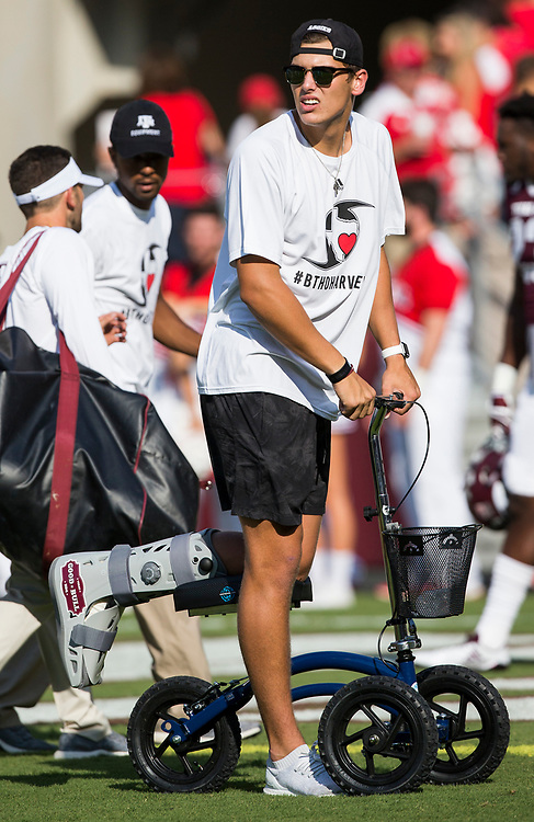 Injured Texas A&M quarterback Nick Starkel (17) watches his team in warmups before the start of an NCAA college football game against Nicholls State Saturday, Sept. 9, 2017, in College Station, Texas. Texas A&M won 24-14. (AP Photo/Sam Craft)