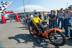 The 1923 Neracar rides over the finish line at the end of stage 16 (142 miles) of the Motorcycle Cannonball Cross-Country Endurance Run, which on this day ran from Yakima to Tacoma, WA, USA. Sunday, September 21, 2014.  Photography ©2014 Michael Lichter.
