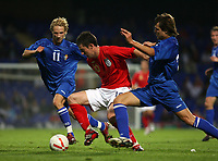 Photo: Chris Ratcliffe.<br /> England U21 v Moldova U21. European Championship Qualifier. 15/08/2006.<br /> David Nugent of England U21 clashes with Alexandr Suvorov (L) and Alexandru Epureanu of Moldova U21.
