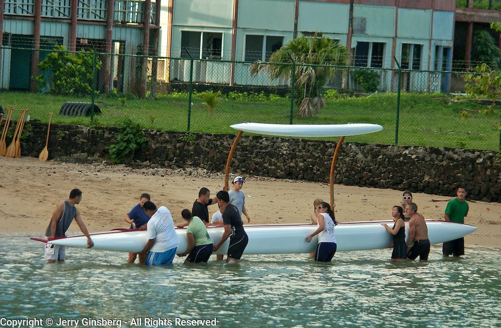 Spirited teams prapare to practice their paddling skills in the bay at Pago Pago, Tutuila, American Samoa.