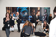 RICHARD SYKES IN FRONT OF ISAAC JULIEN; VICTORIA MIRO SITTING DOWN. VICTORIA MIRO GALLERY, , opening of the 2010 Frieze art fair. Regent's Park. London. 13 October 2010. -DO NOT ARCHIVE-© Copyright Photograph by Dafydd Jones. 248 Clapham Rd. London SW9 0PZ. Tel 0207 820 0771. www.dafjones.com.