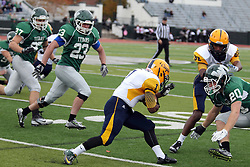18 October 2014:  Brandon Price crouches to protect from an impending hit from Zach Till (DB) during an NCAA division 3 football game between the Augustana Vikings and the Illinois Wesleyan Titans in Tucci Stadium on Wilder Field, Bloomington IL