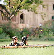 Two young girls play in a pond in the Begum Hazrat Mahal Park, Lucknow, Uttar Pradesh, India
