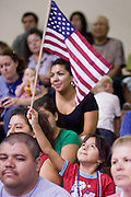 July 4, 2008 -- Phoenix, AZ: Spectators watch the naturalization ceremony for new US citizens at South Mountain Community College in Phoenix, AZ. About 300 people from 41 countries were naturalized as US citizens at South Mountain Community College, in Phoenix, AZ, Friday. It was the 20th year the college has hosted the Fiesta of Independence. More than 5,000 people have become naturalized US citizens at the Fiesta of Independence. More than 5,000 people have become naturalized US citizens at the Fiesta of Independence. The largest number of new citizens, 158, came from Mexico. There were also large numbers of new citizens from the Philippines, Bosnia-Herzegovnia and India.  Photo by Jack Kurtz