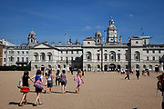 Tourists walk towards the Old Admiralty Building on Horse Gurads Parade in St James', central London.