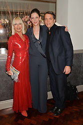 Left to right, VIRGINIA BATES, MARIA GRACHVOGEL and her husband MIKE SIMCOCK at a dinner to celebrate 20 years of Maria Grachvogel's fashion label held at Salmontini, 1 Pont Street, London on 22nd October 2014.