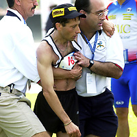 PIT2000050705 - PITTSBURGH, PENNASYLVANIA, USA:  Fifth place finisher Eddy Hellebuyck is helped to a medical aid area by Marathon Officals Rich Wright (L) and Race Director Larry Goldman following The U.S. Olympics Mens Marathon Trails in Pittsburgh Pennasylvania. UPI ac/Archie Carpenter