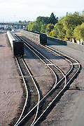 Railroad cars sit along two of the three railroad tracks. Missoula Photographer, Missoula Photographers, Montana Pictures, Montana Photos, Photos of Montana