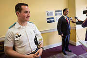 Citadel cadet Jonathan Santorum waits as his father former U.S. Senator Rick Santorum speaks to local media after addressing the South Carolina National Security Action Summit on March 14, 2015 in West Columbia, South Carolina.