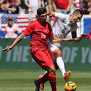 Clint Dempsey, (right), USA, and Ozan Tufan, Turkey, tussle for the ball during the US Men's National Team Vs Turkey friendly match at Red Bull Arena.  The game was part of the USA teams three-game send-off series in preparation for the 2014 FIFA World Cup in Brazil. Red Bull Arena, Harrison, New Jersey. USA. 1st June 2014. Photo Tim Clayton