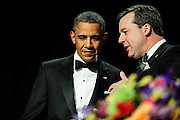 President Barack Obama talks with Ed Henry, president of the of the White House Correspondents' Association (WHCA) during the organization's annual dinner in Washington, District of Columbia, U.S., on Thursday, April 27, 2013. Photographer: Pete Marovich/Bloomberg