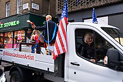 (EDITORS NOTE: Image contains graphic material) Explicit art installation 'Donald Trump and Miss Universe' by English artist Alison Jackson on the back of a truck in Soho on 30th October 2020 in London, United Kingdom. The artwork shows Donald Trump with American flags, wearing a Miss Universe sash having intercourse with a woman in a red dress balanced on a table. Jackson (seen here in the truck) is a contemporary BAFTA and multi award winning artist who explores the cult of celebrity and is known in particular for her photographs of lookalike celebrities.