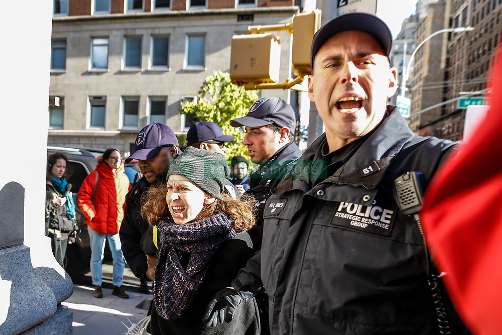 November 10, 2018 - New York, New York, U.S. - Police arrest a woman during a protest against fascism and anti-Semitism on the Upper East Side on Manhattan Island in New York City. Three protesters were arrested  (Credit Image: © William Volcov/ZUMA Wire)