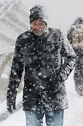 © Licensed to London News Pictures. 28/02/2018. London, UK. A man walks across Millennium Bridge as heavy snowfall hits central London at lunchtime. The cold spell named The Beast From The East is due to last a few days. Photo credit: Ray Tang/LNP