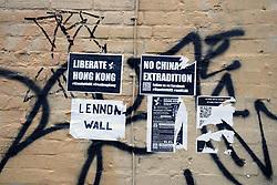 Liberate Hong Kong flyers on Norwich wall, UK Aug 2019