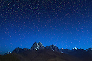 Moonlit view of the twin peaks of Mount Ushba (4710m) in the Svaneti region of the Caucasus Mountains in northwestern Georgia.