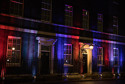 London, UK. 31 January, 2020. Red, white and blue lines are projected onto the exterior of 10 Downing Street on the evening when the UK leaves the European Union.