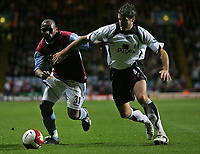 Photo: Lee Earle.<br /> Aston Villa v Fulham. The Barclays Premiership. 21/10/2006. Villa's Didier Agathe (L) battles with Franck Queudrue.