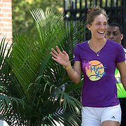 August 19, 2014, New Haven, CT:<br /> Andrea Petkovic waves to fans on day five of the 2014 Connecticut Open at the Yale University Tennis Center in New Haven, Connecticut Tuesday, August 19, 2014.<br /> (Photo by Billie Weiss/Connecticut Open)