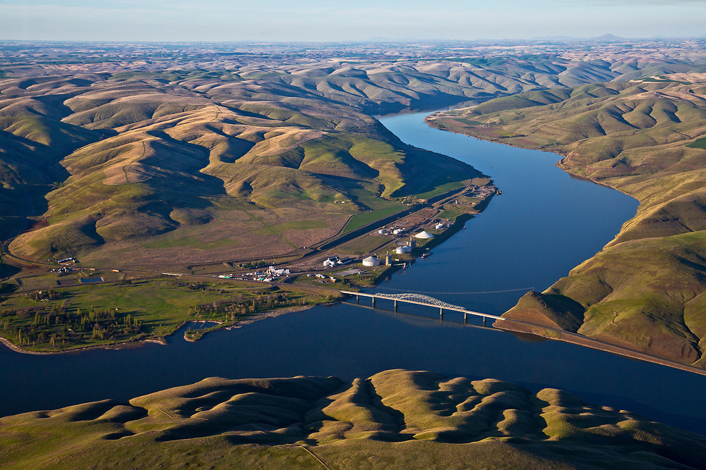 Aerial view of bridge and shipping docks for barges and river boats to load crops and produce for journey down river to confluence with the Columbia River and onward to Portland Oregon. Licensing - Open Edition Prints
