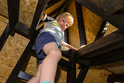 Dad of two Tom Prior has created a beautiful shingle clad, two floor play house in the garden of his Shoreham, West Sussex home for his children. Tom's son Jackson, 4, loves the sense of adventure in the two-storey playhouse. Shoreham, West Sussex, July 15 2019.