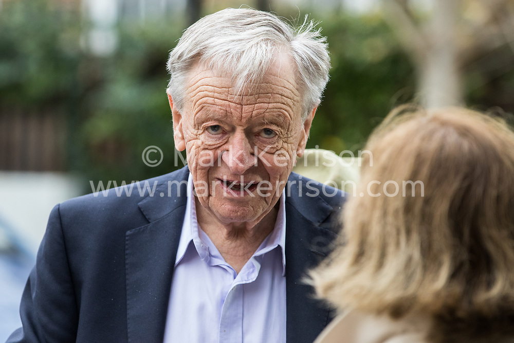 London, UK. 26 November, 2019. Lord Dubs is interviewed outside the Bernie Grant Arts Centre in Tottenham before the launch of Labour's new Race and Faith Manifesto.