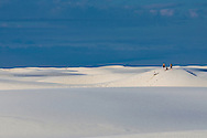 Visitors play in the sand at White Sands National Monument, New Mexico.