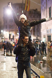 © licensed to London News Pictures. London, UK 01/01/2014. Revellers in Trafalgar Square, London celebrating the New Year at the first hours of 2014. Photo credit: Tolga Akmen/LNP
