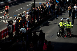 © Licensed to London News Pictures. 21/04/2013. London, UK. Police officers keep an eye on the crowd during the Virgin London Marathon 2013 on April 21, 2013 in London, England. Photo credit : Peter Kollanyi/LNP