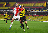 Football - 2020 / 2021 Sky bet Championship - Watford vs Stoke City - Vicarage Road<br /> <br /> Stoke City's Nick Powell battles with Watford's Ben Wilmot.<br /> <br /> COLORSPORT/ASHLEY WESTERN